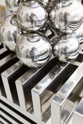 silver balls on a silver pedestal