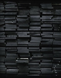 black wooden boards stacked on a pile