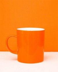 orange mug in orange background